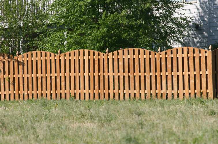 AFC Iowa City - Wood Fencing, 1013 6' overscallop board on board stained