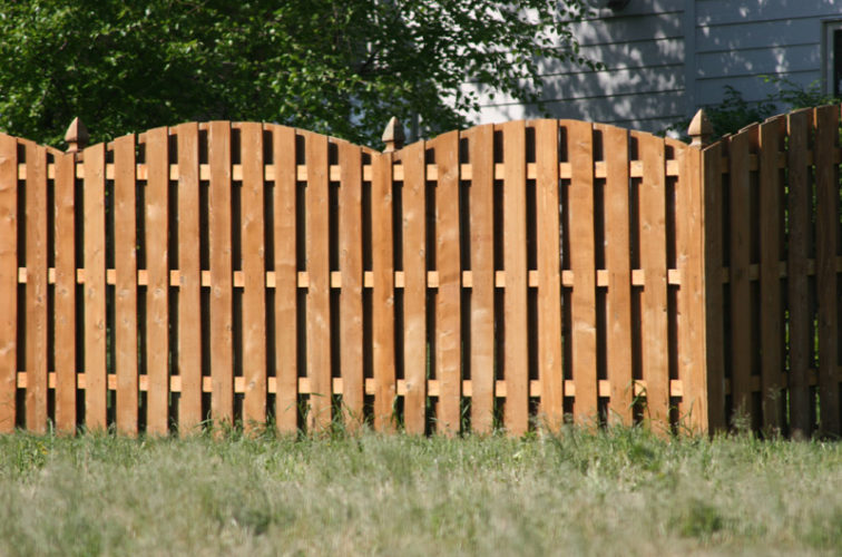 AFC Iowa City - Wood Fencing, 1015 6' overscallop board on board stained