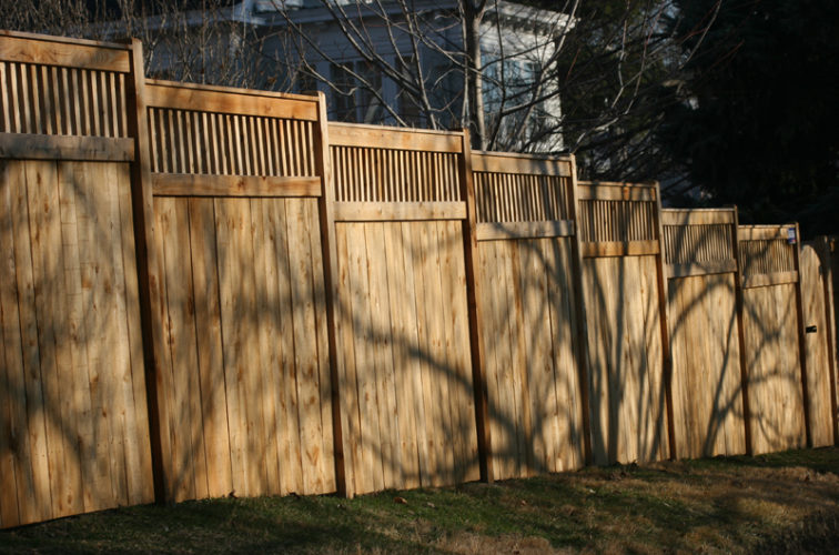 AFC Iowa City - Wood Fencing, 1055 Custom Solid with Accent Top