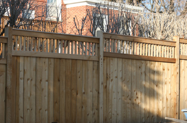 AFC Iowa City - Wood Fencing, 1060 Custom Solid with Accent Top