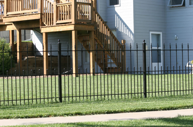 AFC Iowa City - Custom Iron Gate Fencing,1200 4' alternating pickets with balss and quadflares