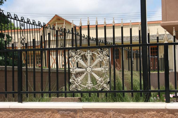 AFC Iowa City - Custom Iron Gate Fencing, 1230 Overscallop with quad flare & emblem