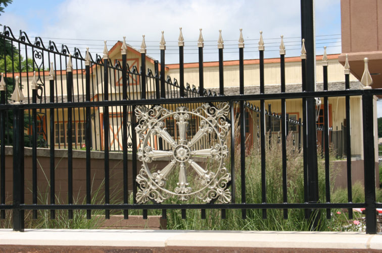 AFC Iowa City - Custom Iron Gate Fencing, 1231 Overscallop with quadflare & emblem