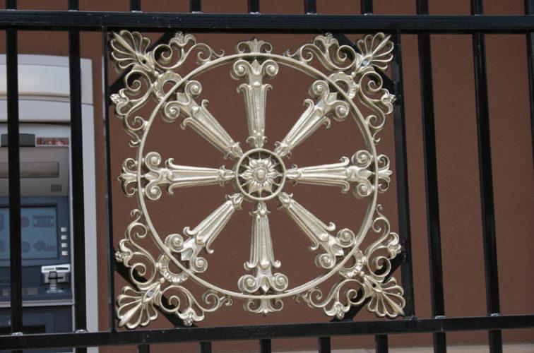 AFC Iowa City - Custom Iron Gate Fencing, 1232 Overscallop with quadflare & emblem