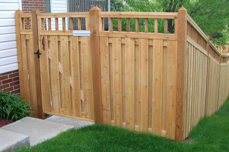 AFC Iowa City - Wood Fencing, Custom with wood picket accent