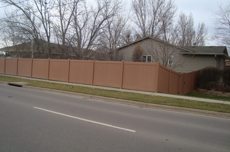 AFC Iowa City - Vinyl Fencing, Solid Privacy Cedar Tone