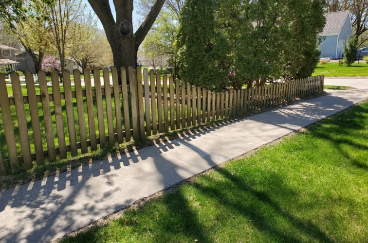 American Fence Company - Sloped Dog Eared Wood Picket Fence